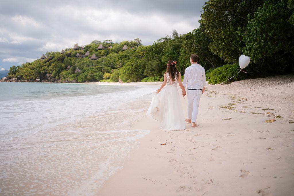 Couple walking on beach for destination weddings photographer